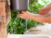 Little child washing hands — Stock Photo