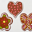 Heart, flower and butterfly shaped cookies on white wooden surface — Stock Photo #39018227