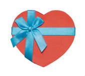 Heart-shaped box tied with blue ribbon — Stockfoto