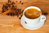 Coffee cup on the wood decorated coffee beans — Stock Photo