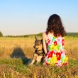 Young woman sitting with her dog — Stock Photo #39303531