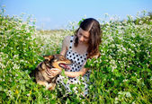Young happy girl with dog — Stock Photo