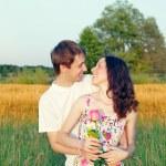 Loving young man hugging his girlfriend — Stock Photo