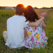 Young couple sitting back to camera — Stock Photo