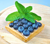 Blueberry shortcake decorated with mint — Stock Photo