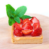 Strawberry shortcake decorated with mint — Stock Photo