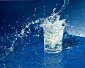 Splashing water from glass — Stock Photo