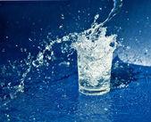 Splashing water from glass — Stock Photo