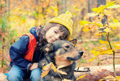 Sad little girl with big dog — Stock Photo