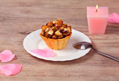 Cupcake with nuts and honey — Stock Photo