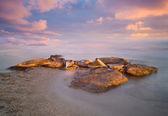 Stones on a sandy beach — Stock Photo
