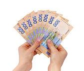 Female hands holding a fan of money — Foto de Stock