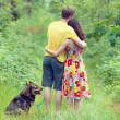 Couple in forest with dog — Stock Photo