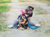Sad girl and dog — Photo