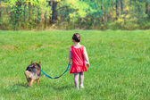 Girl and dog on lawn — Foto Stock