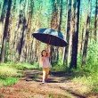 Girl with big black umbrella — Stock Photo