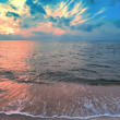 Magic colorful sunset over seashore — Stock Photo