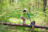 Little girl with her dog jumping — Foto Stock