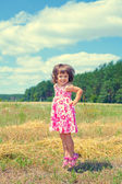 Happy little girl jumping in the meadow — 图库照片