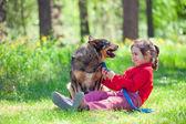 Happy little girl with big dog — Stock Photo