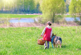Girl walking and going to picnic with dog — Stock Photo