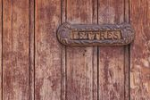 Letterbox on a french door — Stock Photo