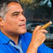 Stock Photo: Cigar smoker