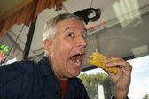Man eating a taco — Foto de Stock