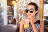 Pretty girl sipping — Stock Photo