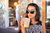 Pretty girl sipping — Stockfoto