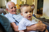Baby boy with great grandfather — Stock Photo