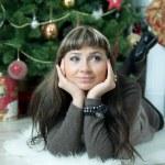 Beautiful girl celebrates Christmas — Stock Photo #38708957