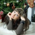 Beautiful girl celebrates Christmas — Stock Photo #38708979