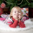 A little girl getting a Christmas gift — Stock Photo