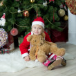 Little girl in front of christmas-tree — Stok fotoğraf