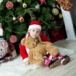 Little girl in front of christmas-tree — Stockfoto
