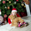 Little girl in front of christmas-tree — Stock fotografie