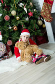 Little girl in front of christmas-tree — Stock Photo