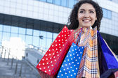 Happy girl with shopping — Stock Photo
