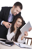 Funny girl and the guy with the pad — Stock Photo