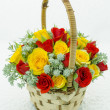 Basket with roses — Stock Photo