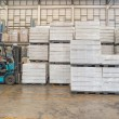 Forklift in the large modern warehouse — Stock Photo #48656077