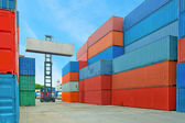 Crane lifter handling container box loading to truck in import e — Stock Photo