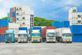 Container trucks in container storage — Stock Photo