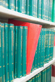 Book in a bookshelf standing out at university library — Stock Photo