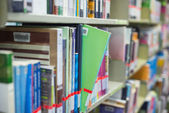Book in a bookshelf standing out at the library — Stock Photo