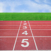 Start or finish position on running track with blue sky — Stock Photo