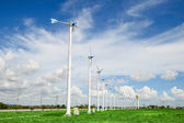 Wind mill power plant against blue sky — Stock Photo