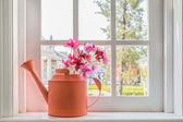 Pot with a flower on the windowsill country house  — Stock Photo