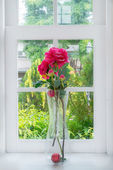 Vase with a flower on the windowsill country house  — Stock Photo